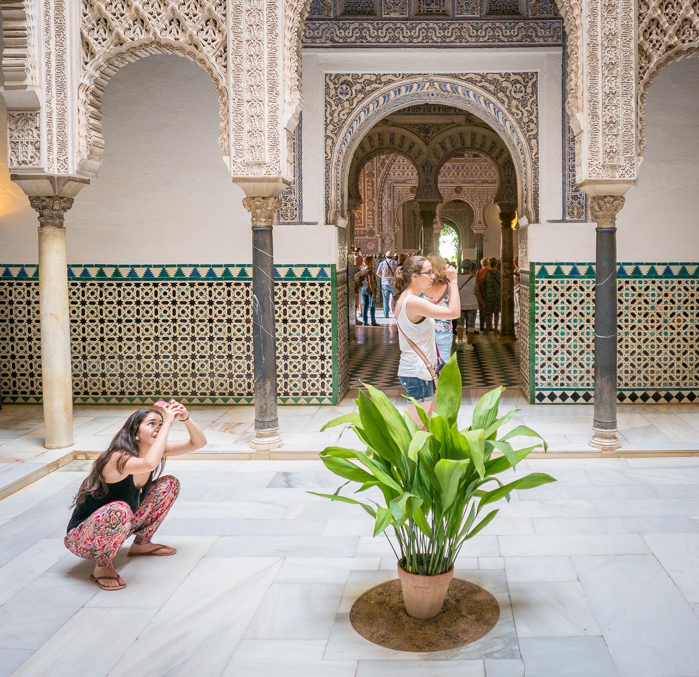 Tourist v traveler: people taking photos at Alcazar