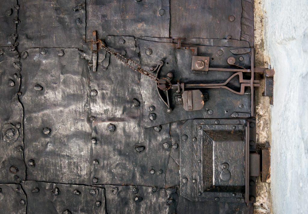 Chiusa, Italy - inside locking mechanism on  black iron door