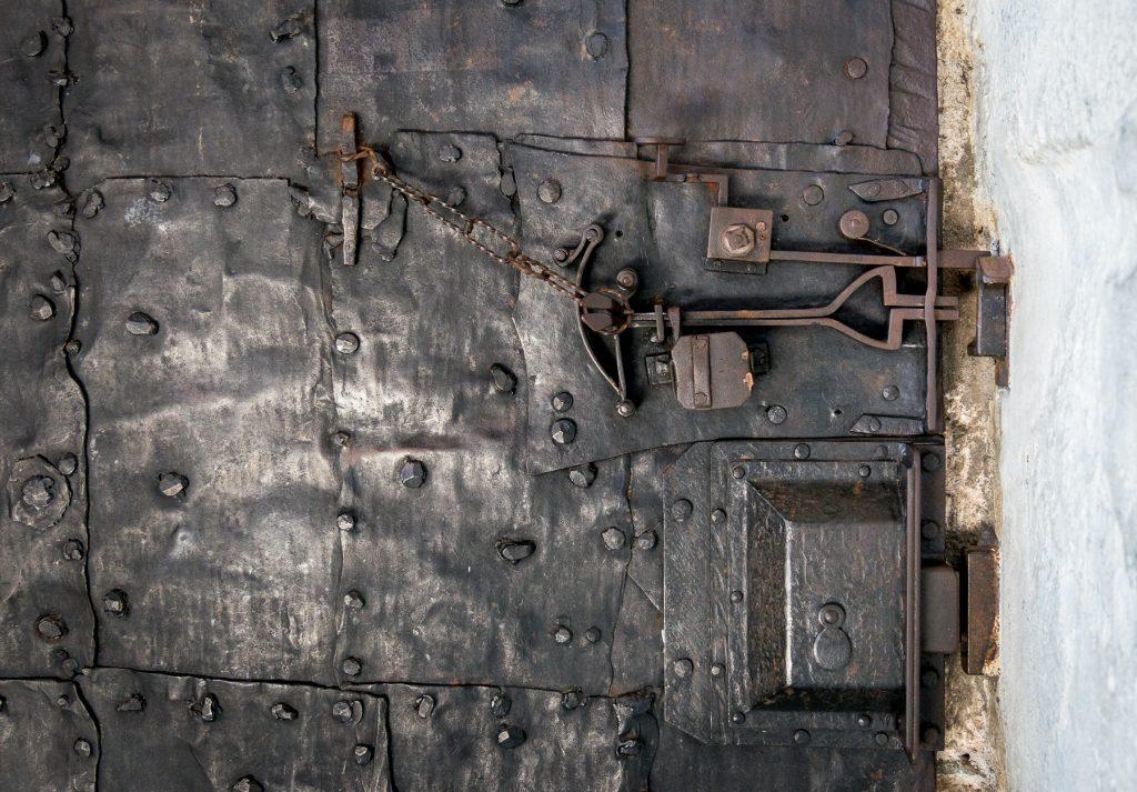 Chiusa, Italy - inside locking mechanism on  black iron door