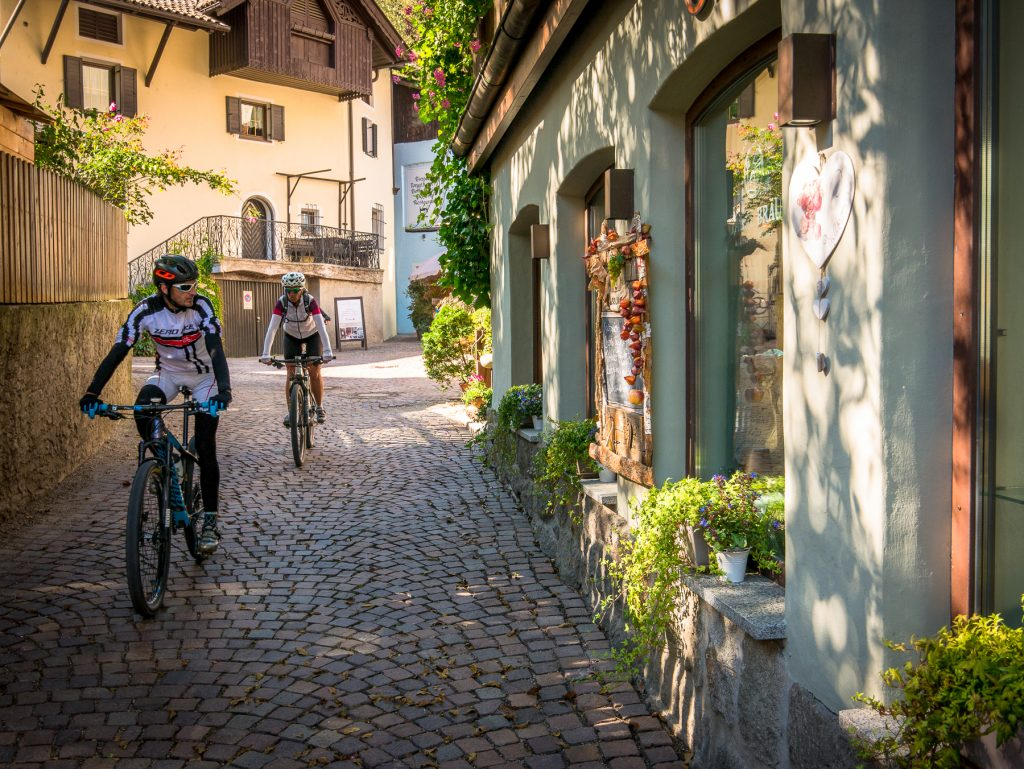 Chiusa, Italy - mountain bikers outside restaurant