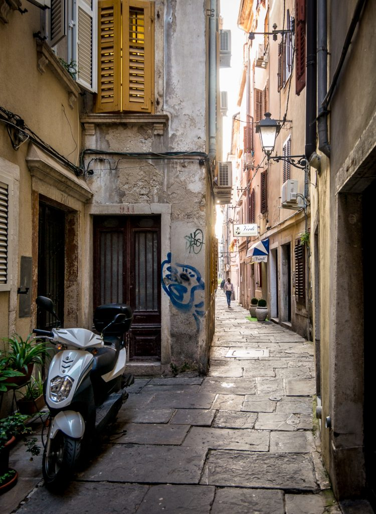 Piran alley with motor scooter