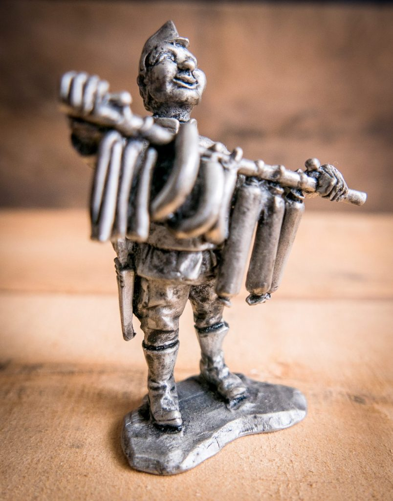 Small pewter sculpture of sausage vendor