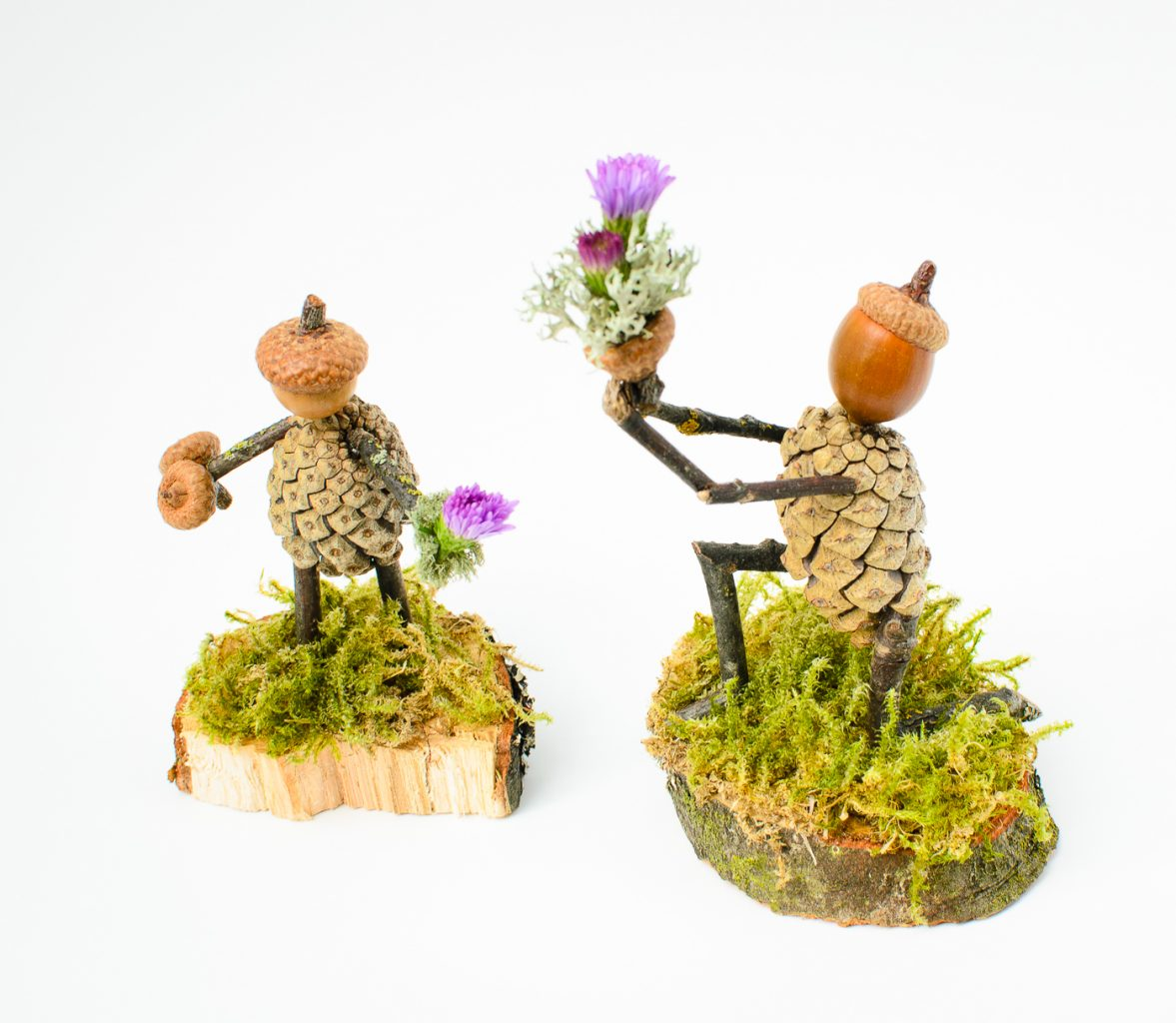 Small sculptures made from pinecones and acorns